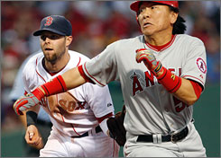 Red Sox second baseman Dustin Pedroia, left, ran down the Angels' Hideki Matsui as he returned to the lineup Tuesday night for the first time since breaking his foot June 25 on a foul ball.