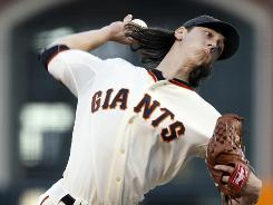 San Francisco starting pitcher Tim Lincecum works against the Colorado Rockies during a 2-1 Giants' victory Wednesday.