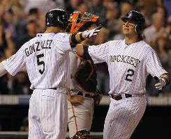 The Rockies may not have made the playoffs, but outfielder Carlos Gonzalez, left, and shortstop Troy Tulowitzki were much more successful with their fantasy teams. Gonzalez flirted with the NL Triple Crown and Tulowitzki had one of the greatest Septembers in history.