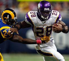 Adrian Peterson, right, might not be piling up yards, but owners that expected a monster season from the Vikings tailback can take solace in his seven touchdowns.