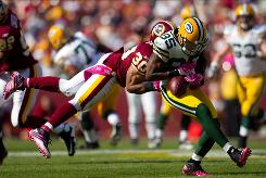 Packers wide receiver Greg Jennings, being tackled by the Redskins' La-Ron Landry on Sunday, doesn't have great statistics, but that could change with one big game.