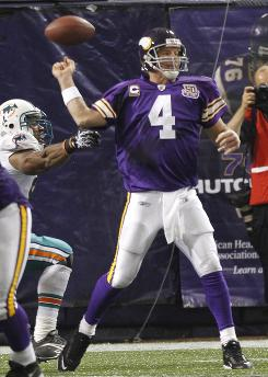Minnesota Vikings quarterback Brett Favre has the ball knocked loose knocked loose by Miami Dolphins linebacker Cameron Wake in Week 2 action.