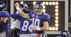 New York Giants quarterback Eli Manning celebrates a touchdown against the Eagles on Dec. 13, 2009
