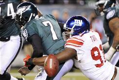 New York Giants defensive end Justin Tuck strips the ball from Philadelphia Eagles quarterback Michael Vick.