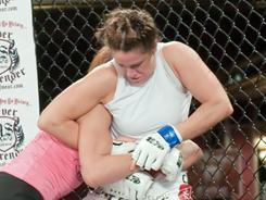 Tara LaRosa, right, attempts a kimura armlock on Takayo Hashi at a Dammage Fight League event on Nov. 24 in Atlantic City