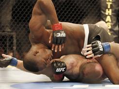 Jon Jones, on top, has won some fights with elbow strikes on downed opponents such as Vladimir Matyushenko.