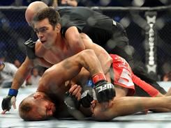 "Lyoto ""The Dragon"" Machida, on top, ended Randy ""The Natural"" Couture's career on Saturday at UFC 129 in Toronto."