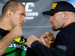 Junior dos Santos, left, and Shane Carwin are among the consensus top-five heavyweights in mixed martial arts.