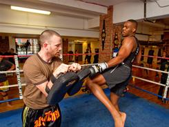 "Jon ""Bones"" Jones, right, demonstrates a knee strike at a recent workout in New York."