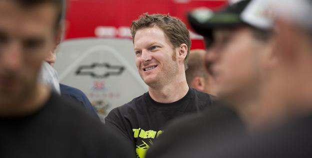Hendrick Motorsports employees line up to greet Dale Earnhardt Jr. on Tuesday at the team's Charlotte shop. Earnhardt picked up his first win since June 2008 on Sunday at Michigan International Speedway.