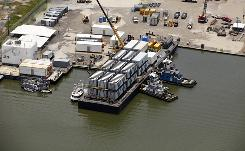 "Floating living quarters for Deepwater Horizon oil spill cleanup workers, known as ""flotels"" are at a dock in Grand Isle, La."