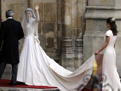 Catherine Middleton waves as she arrives at Westminster Abbey.