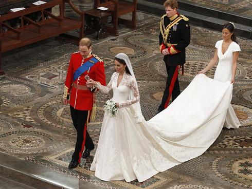 Kate Middleton in her stunning wedding dress with Prince William.