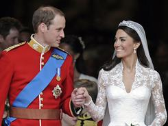 Prince William and his wife Catherine, Duchess of Cambridge, stand outside of Westminster Abbey after their wedding.