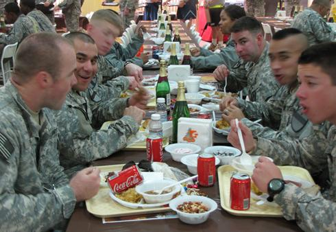 soldiers enjoy a thanksgiving day meal at camp taji iraq a new army initiative is designed to improve the eating habits of soldiers