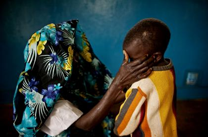 A victim of the New Years rape in Fizu, South Kivu with her son; Photo courtesy of USA Today