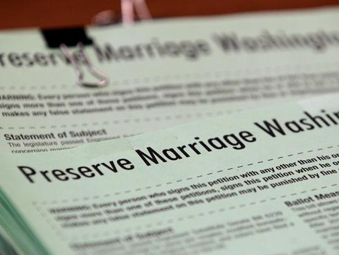 Petitionx large Gregoire signs gay marriage into law