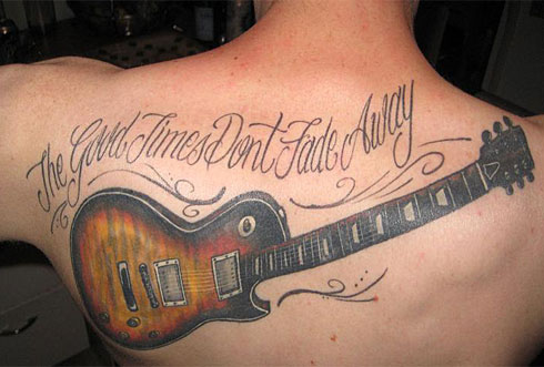 His tattoo shows Duane Allman's guitar and was done at Screamin' Ink.
