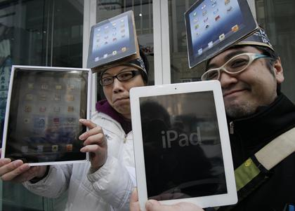 The new iPad: Crowds hit stores for launch