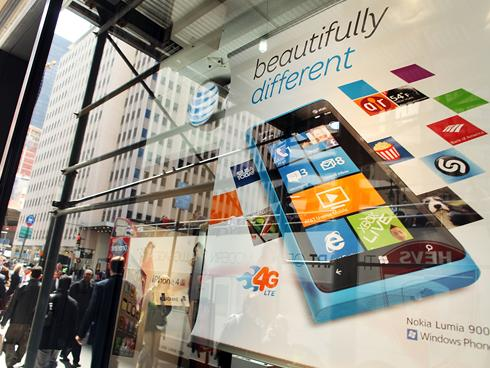 Invitations for an NYC press conference resemble the tile layout of Windows Phone software, pictured here in an advertisement for the Nokia Lumia 900 in New York City.