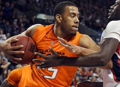 Oklahoma State's Darrell Williams has been charged with a felony count of sexual battery and three felony counts of rape by instrumentation, according to charges filed by the Payne County District Attorney.