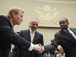 NFL commissioner Roger Goodell, left, and NFLPA chief DeMaurice Smith, right, are at odds with the league having locked the players out.