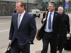NFL commissioner Roger Goodell, left, led a league contingent into the mediation meeting.