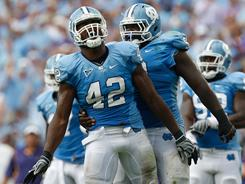 North Carolina products Robert Quinn, left, and Marvin Austin, right, both could be first-round picks in the NFL draft