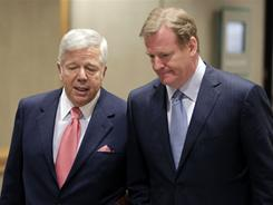NFL commissioner Roger Goodell, right, walks with New England Patriots owner Robert Kraft on Tuesday.