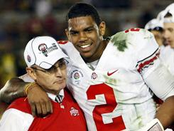 Terrelle Pryor, right, with Jim Tressel, is set to join the pro football ranks.