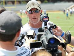 Brett Favre speaks to reporters in Mississippi on Tuesday.