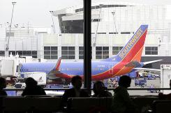 A Southwest Airlines plane sits at a gate at Seattle-Tacoma International Airport.
