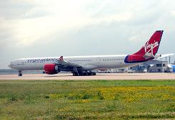 A Virgin Atlantic Airways plane sits on the tarmac at Bradley International Airport in Windsor Locks, Conn.