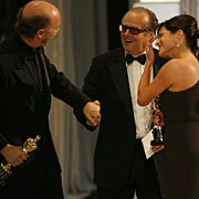 Jack Nicholson, center, congratulates Paul Haggis and Cathy Schulman (Crash).