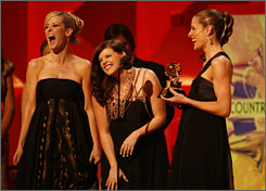 Taking the long way to the top: Martie Maguire, left, Natalie Maines and Emily Robison of the Dixie Chicks won five Grammys Sunday night, including record, song and album of the year.
