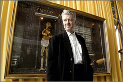 David Lynch poses in front of his painting Wajunga Red Dog 2005, at the Fondation Cartier for modern art in Paris.