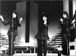 Sexy trio: Estelle Bennett, left, Ronnie Bennett (later Spector) and Nedra Talley perform as The Ronettes on May 26, 1966.