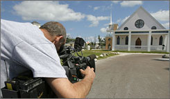 A cameraman records footage of the Mount Horeb Baptist Church in Nassau, Bahamas. Anna Nicole Smith's funeral is expected to take place there later Friday.