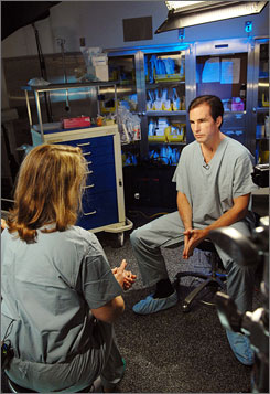 Veterans' advocate: Injured ABC News anchor Bob Woodruff talks with neurosurgeon Gail Rosseau.