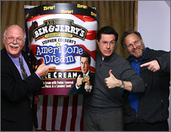 Ben Cohen, left, Stephen Colbert and Jerry Greenfield show off the newest Ben & Jerry's flavor.