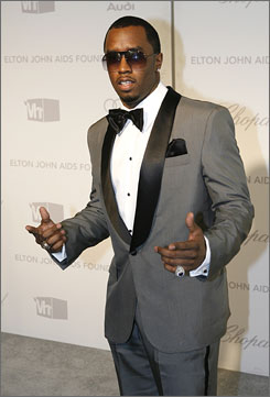 """Sean """"Diddy"""" Combs is being sued by a partygoer who says the rap mogul pushed him and his girlfriend on Feb. 25."""