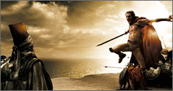 """Honor to the violence"": Stelios (Michael Fassbender) takes a defiant leap toward the Persians in the movie 300."