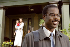 Wandering mind: Director/co-writer/star Chris Rock plays Richard, an investment banker who is married to Gina Torres but can't stop dreaming of other women.