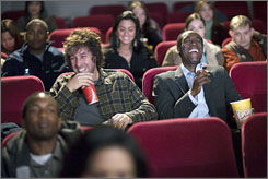 Moments of levity: Adam Sandler, left, and Don Cheadlestar in an otherwise somber film about life after 9/11.