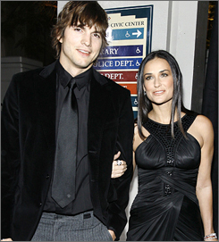 Ashton Kutcher and his wife, actress Demi Moore, attend the Rodeo Drive Walk of Style Award event in Beverly Hills in February.