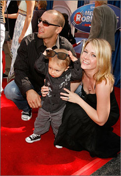 Popcorn time: Actress Melissa Joan Hart, husband Mark Wilkerson and their 14-month-old son, Mason, attend the premiere of Meet the Robinsons on Sunday.