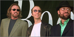 The Bee Gees will be honored at the BMI's annual Pop Awards on May 15. The family act lost brother Maurice, right, in 2003 when he died following emergency surgery.