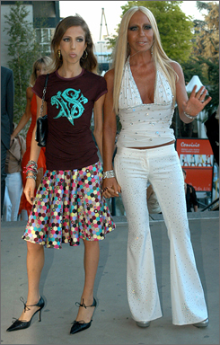 Donatella Versace, right, and daughter Allegra wave to photographers in Milan on June 10, 2004.