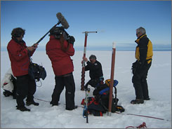 In Antarctica: 60 Minutes' Scott Pelley, right, watches climatologist Paul Mayewski take a sample from a glacier for his story on global warming.