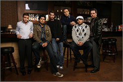 Bar buddies: The HBO series, with Kevin Connolly, left, Adrian Grenier, creator Doug Ellin, Jeremy Piven, Jerry Ferrara and Kevin Dillon, returns Sunday.